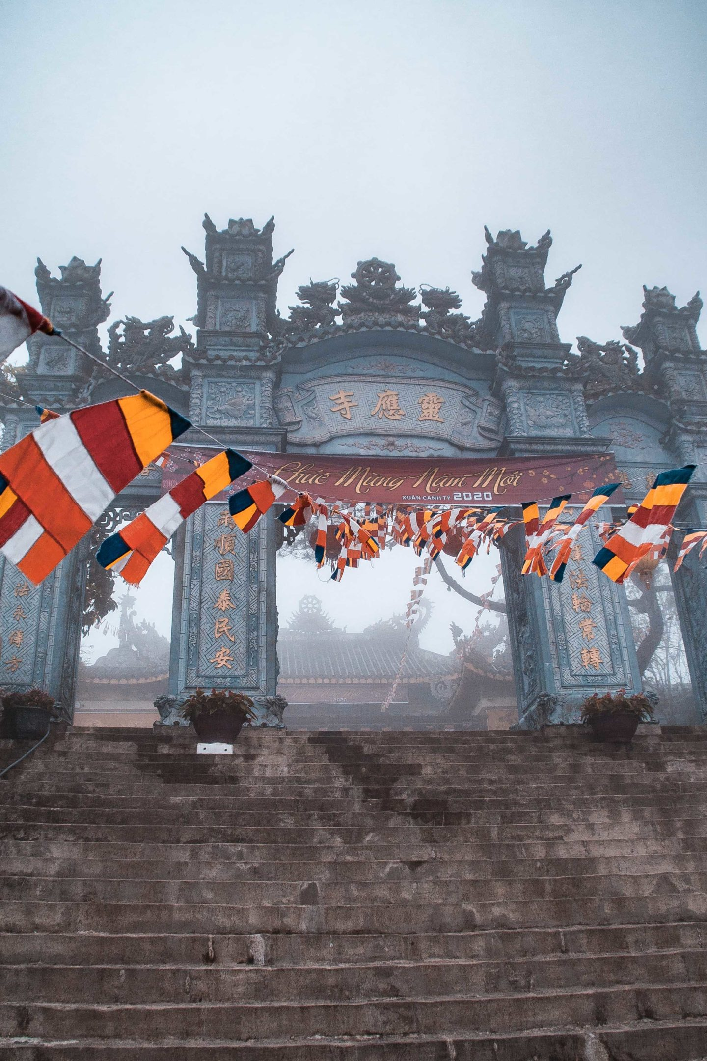 Flags garlants of a Buddhist temple in Ba Na Hills