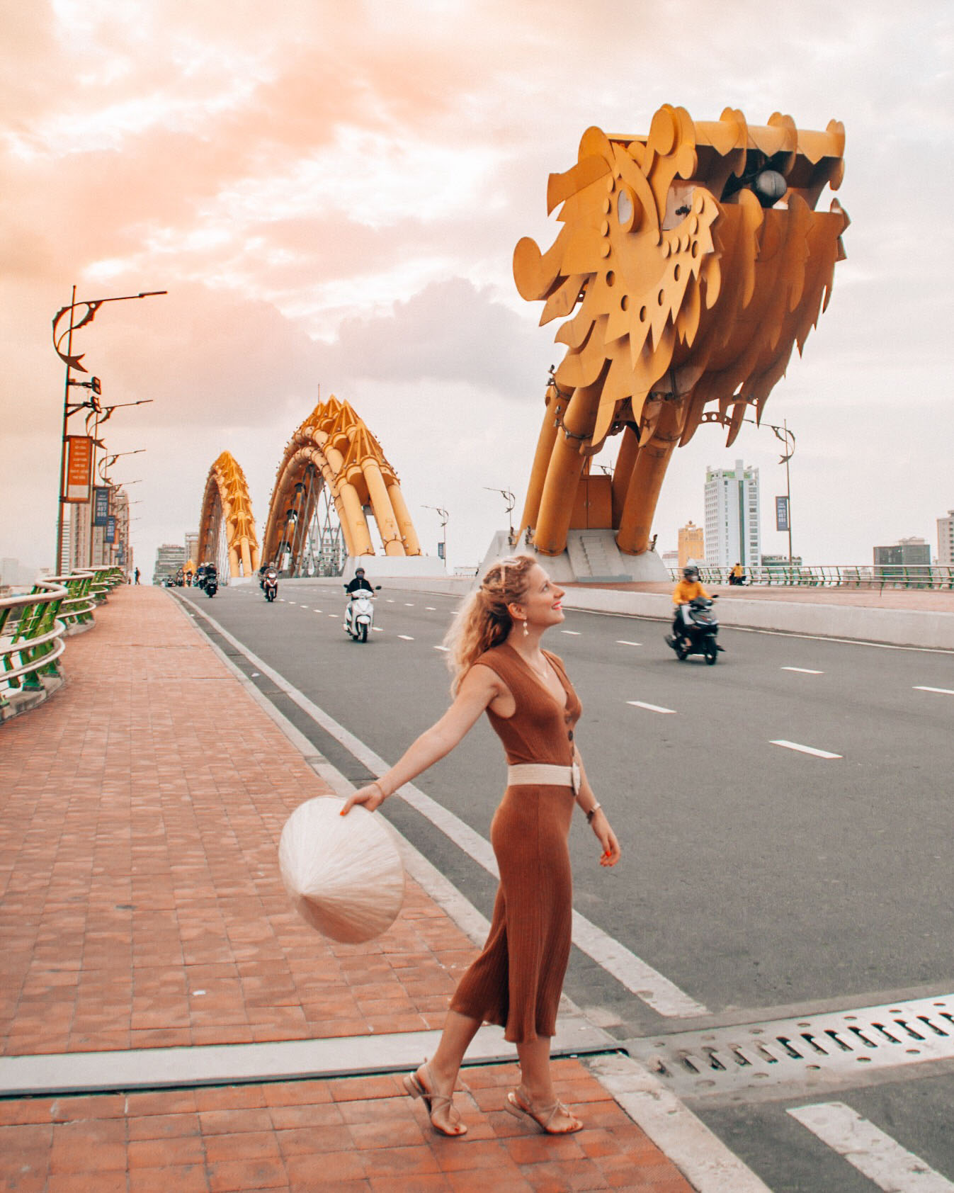 Enjoy the sunset golden hour colors on the Dragon Bridge in Da Nang, Vietnam
