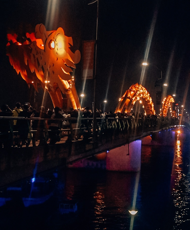 The Dragon Bridge by night in Da Nang, Vietnam