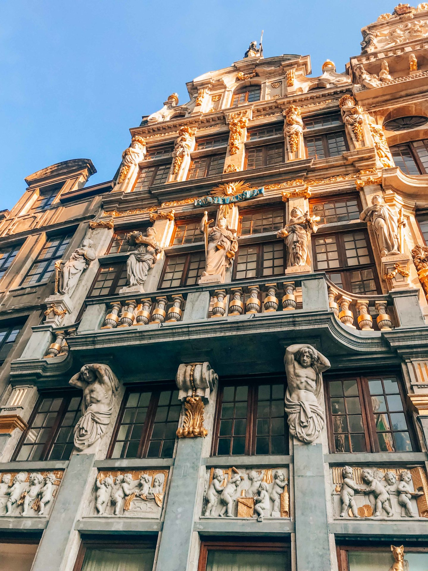 Golden details on the Grand Place buildings