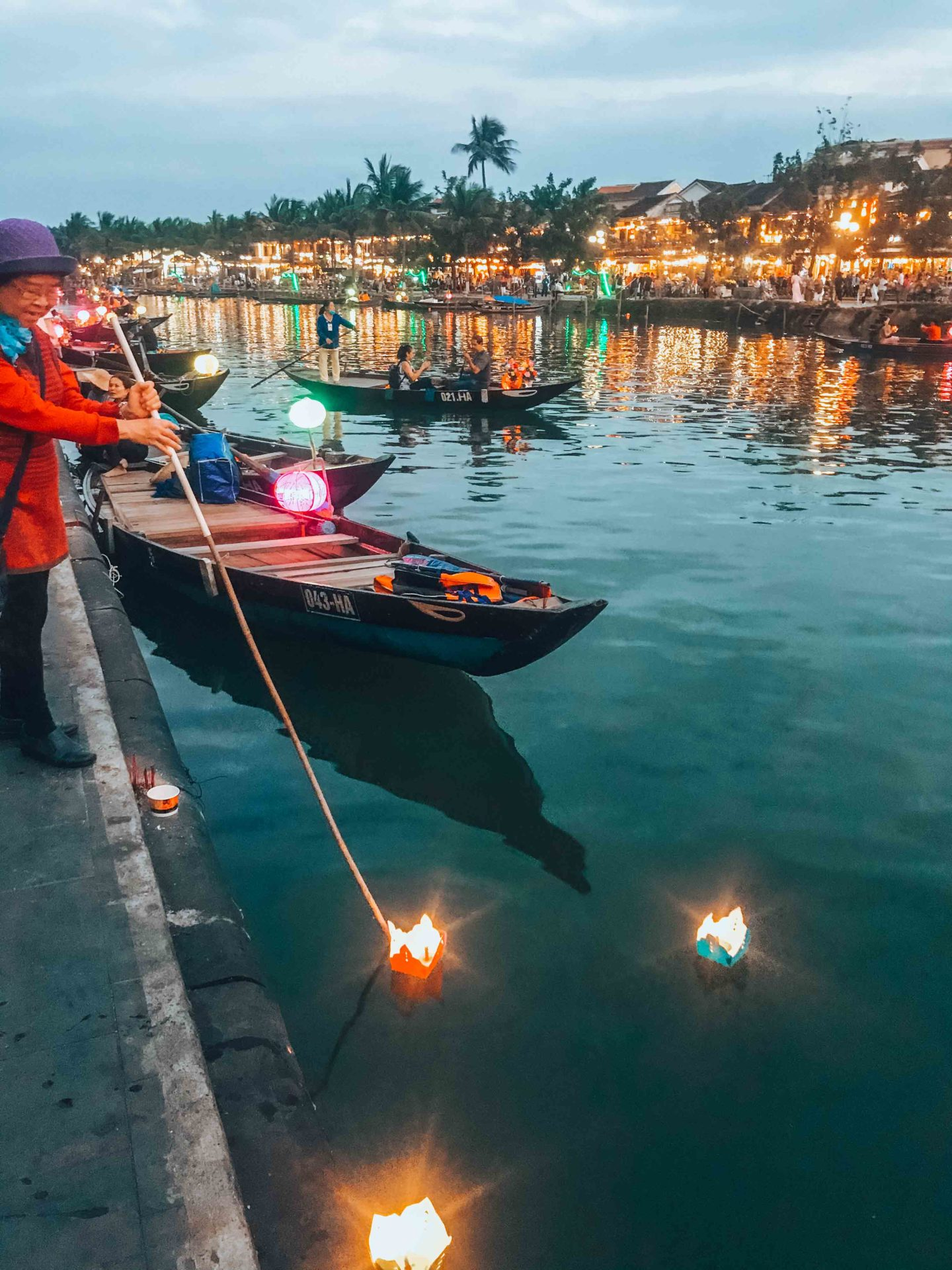 Hoi An river by night with magical lanterns and lights