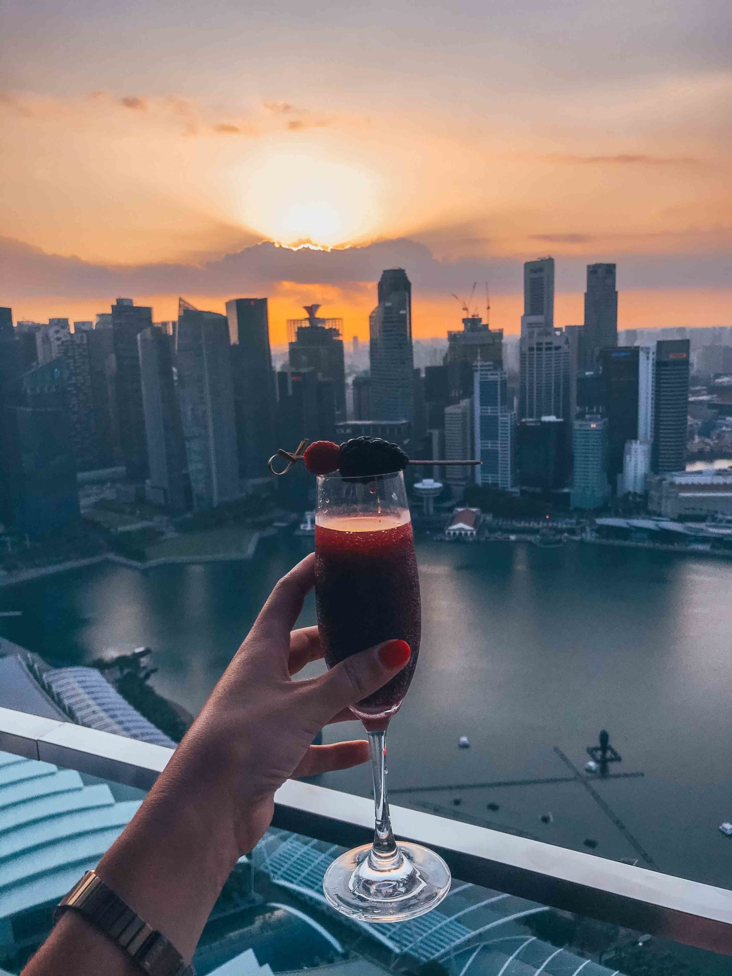 Having a drink at sunset on top of the Marina Bay Sands, Singapore