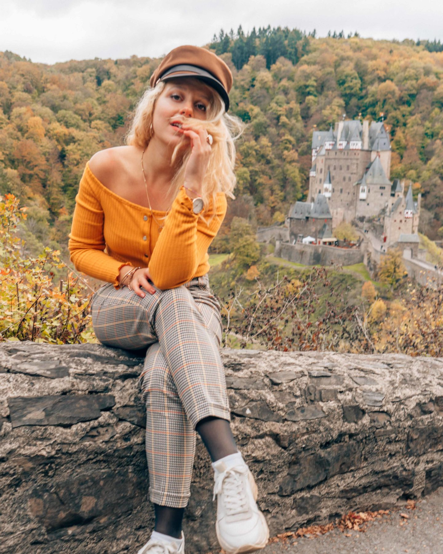 Burg Eltz surrounded by fall foliage